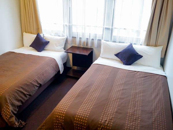 眠り心地にこだわり、全室シモンズベッドを使用。